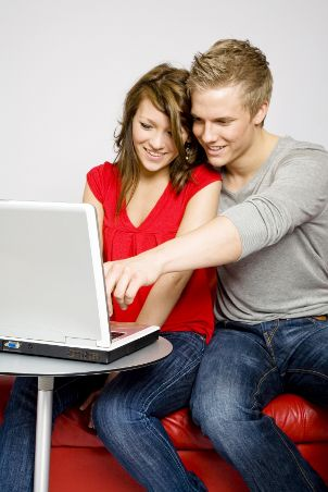 Young couple setting up a bridal registry