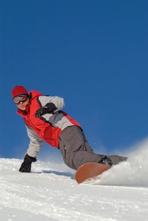 Snowboarder riding his toe-side edge