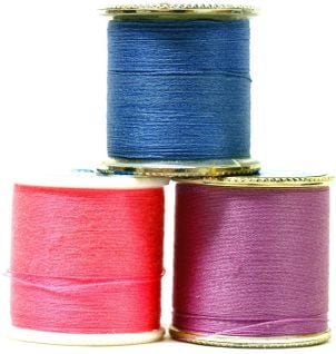 Pink, blue and purple sewing machine thread
