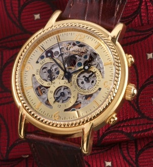 Men's antique gold watch with a leather watchband