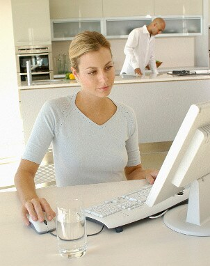 Woman browsing the Web with a cable modem