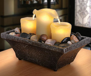 Centerpiece with candles and polished rocks