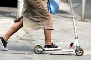Woman riding a kick scooter