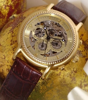 Gold watch with a leather watch strap