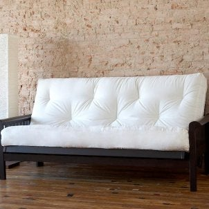 Ivory futon mattress on a wood futon frame