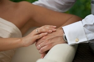 Bride and groom wearing wedding bands