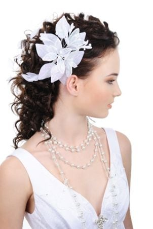 Brunette bride with white flowers in her hair