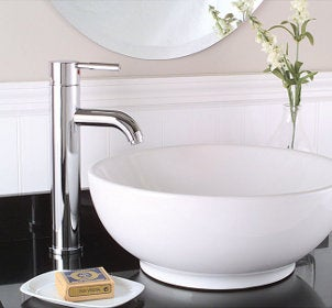 White porcelain vessel sink on a grey countertop