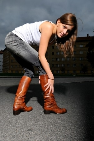 Woman wearing cute jeans and boots