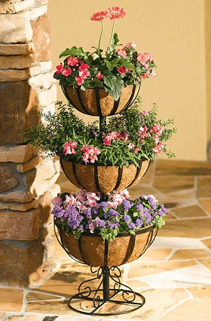 Hanging copper planter with pink flowers