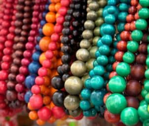 Strings of colorful wooden beads