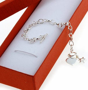 A pretty piece of sterling silver children's jewelry in an orange gift box