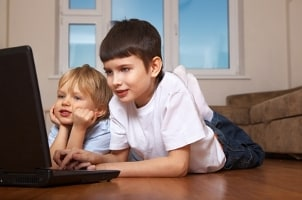 Boys playing games on a laptop