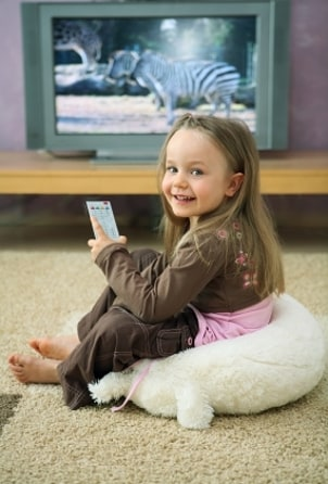 Little girl watching a cheap LCD TV
