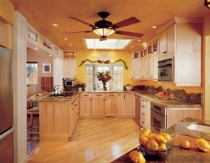 Lovely kitchen decorated with flowers, garlands and bowls of fruit