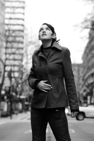 Woman wearing black peacoat in city