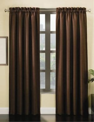 Brown curtains on a silver curtain rod