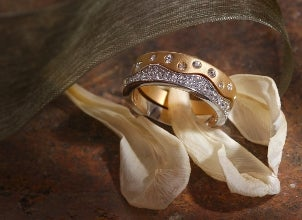 Two pretty diamond band-style rings, one in yellow gold and one in white gold