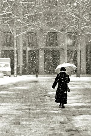 Woman wearing a long down coat in the snow