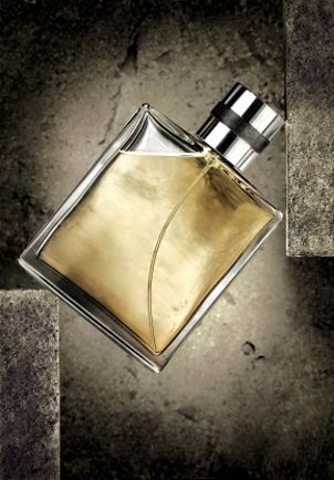 Cologne bottle against slate background