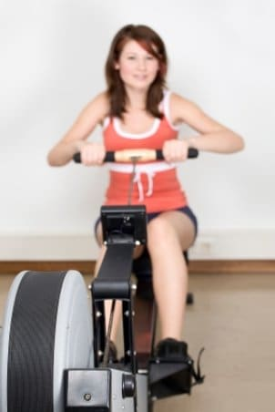 An avid exerciser going wild on the rowing machine
