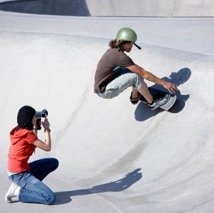 Female photographer taking photos of a skateboarder