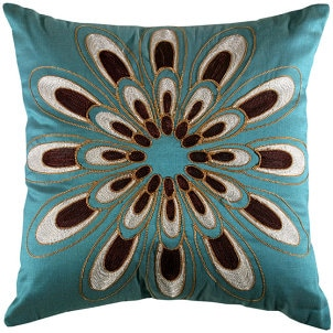 A decorative pillow in a friendly floral print
