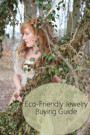A lovely redhead wears eco-friendly jewelry and a vintage party dress in the woods