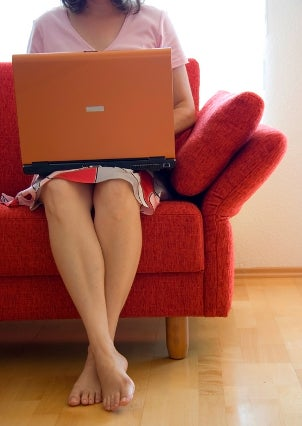 Woman on a couch using a discount computer