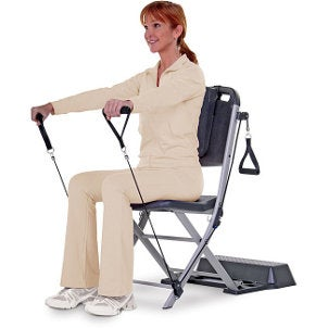 Woman working out using a resistance chair