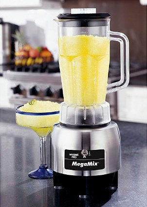 Brushed-steel blender with yellow slushy drink