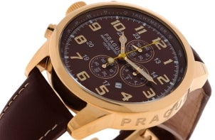 A handsome men's watch with a brown dial, a gold case and brown leather watchbands