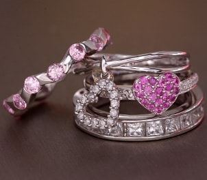 A stack of lovely rings with pink and white diamonds