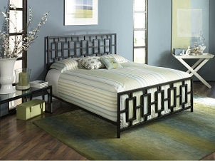 Blue and green bedroom with wooden bed frame