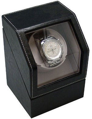 A handsome black leather watch winder containing a stainless steel watch