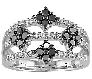An ornate and unique black diamond ring with white diamonds and a cluster setting