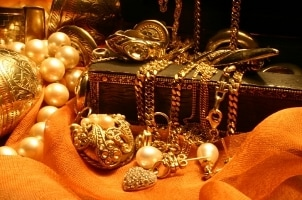 A pile of priceless precious metal jewelry and other lovely treasures