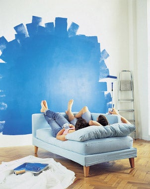 Couple painting a wall for home improvement