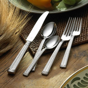 5-piece stainless steel flatware set with intricately designed handles