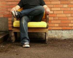 Guy sitting in a yellow chair wearing comfortable men's jeans