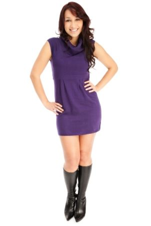 Woman wearing purple sweater dress and boots