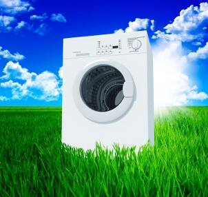 Environmentally friendly clothes washer in a green grassy field