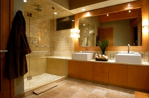 Large walk-in glass shower with honey tile