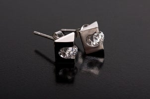 A pair of very unique titanium and diamond stud earrings with an interesting geometric shape