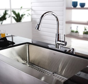 Chrome kitchen faucet over a steel sink
