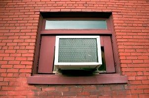 Air conditioner in a window of a red brick building