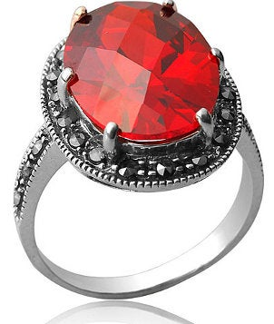A very unique engagement ring with a bright red gemstone