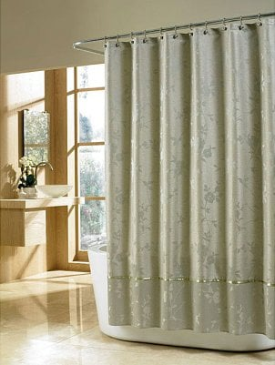 A cloth shower curtain in soothing sage
