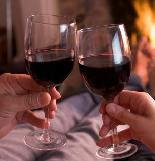 A couple toasts with red wine