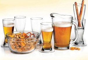 Full pitcher of beer and glasses ready to be filled